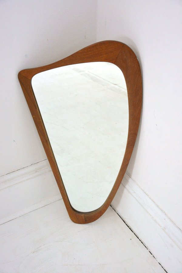 Sculpturally Shaped Danish Mirror In Teak That Is Very Typical Of The Modernist Aesthetic